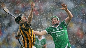 Jackie Tyrell and Shane Dowling compete for a high ball