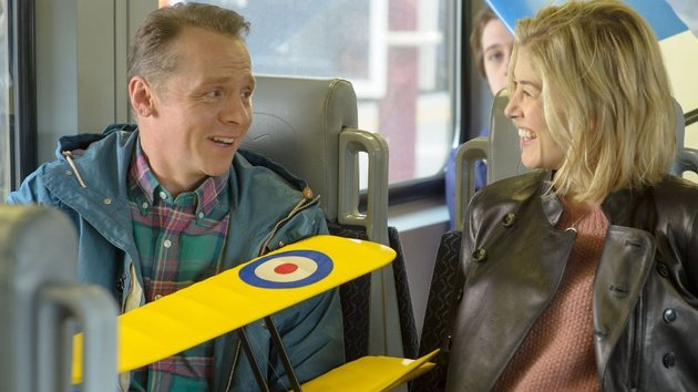 Simon Pegg as Hector and Toni Collette as his girlfriend Clara who encourages him to travel the world in search of the meaning of happiness