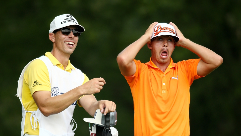 Ricky Fowler reacts to this shot on the fifth - a hole he birdied - as caddie Joe Skovron sees the funny side. Fowler and Mickelson held the lead round the turn.