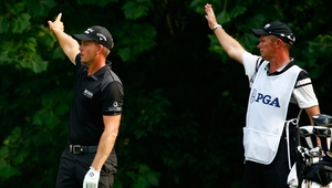 FORE! Henrik Stenson and his caddie signal a rare wayward shot - the Swede took just 30 shots for his front nine