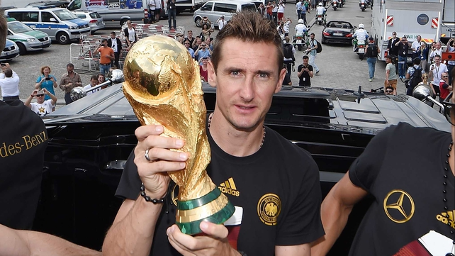 Miroslav Klose poses with the World Cup