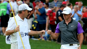 Caddie JP Fitzgerald and McIlroy after McIlroy had rolled in the putt from seven feet to claim the eagle that put him back in control of the championship