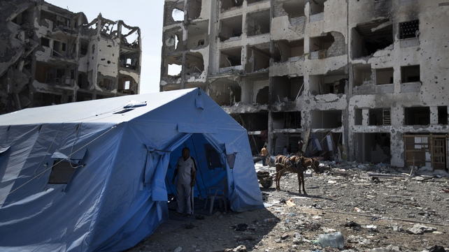 A tent pitched in front of the destroyed Nada Towers in Gaza