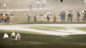Fans wait out a downpour during the final round of the PGA Championship at Valhalla, Kentucky