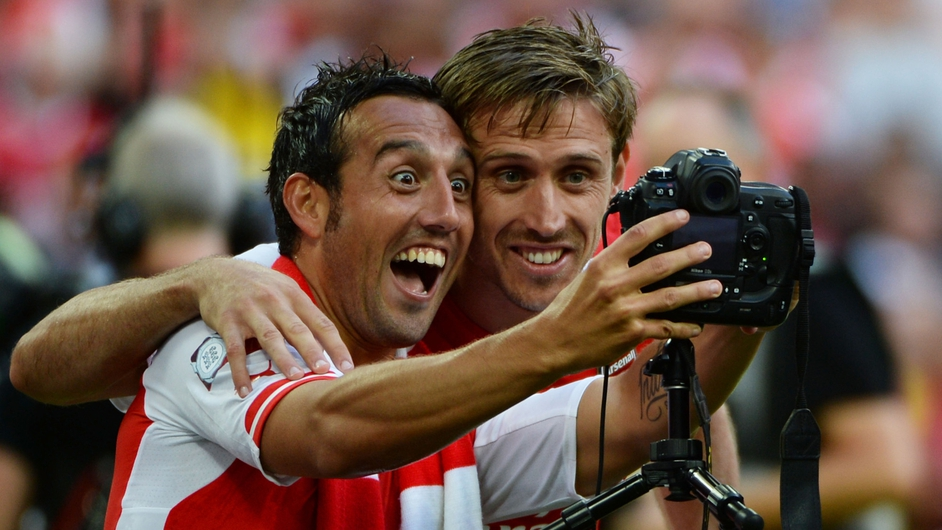 Arsenal's Santi Cazorla and Nacho Monreal take a 'selfie' after their Community Shield match win over Manchester City