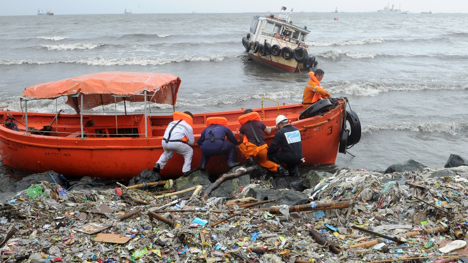 Maritime students secure life boats that they used after losing power at sea in Manila Bay