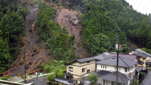 Heavy rains caused a landslide next to a group of houses in Kochi, Japan