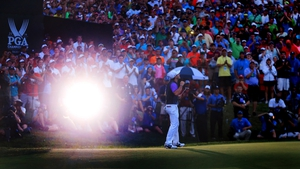 In near-darkness, McIlroy holes the winning putt