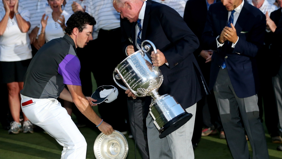 Still sharp, McIlroy saves the top part of the massive Wannamaker Trophy from hitting the turf during the presentation