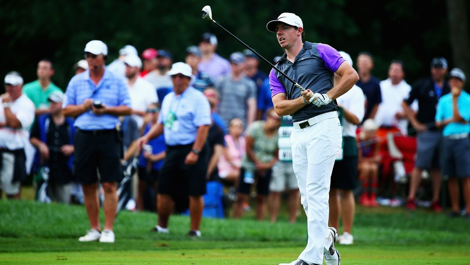 The key shot: McIlroy watches his 3-wood cut streak down the left of the par-five tenth hole