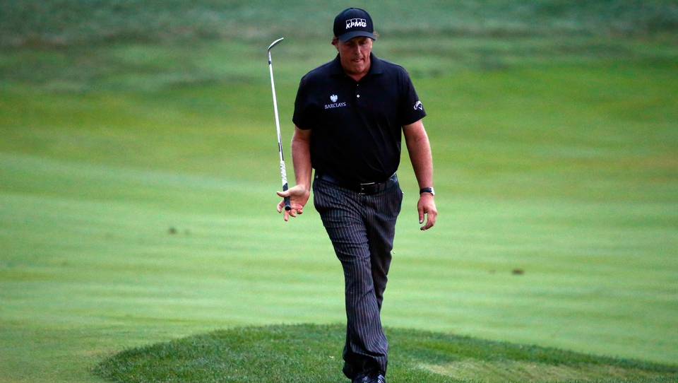 This Major was once branded 'Glory's Last Shot'... Mickelson's valiant chip for eagle rolled just past the hole on 18