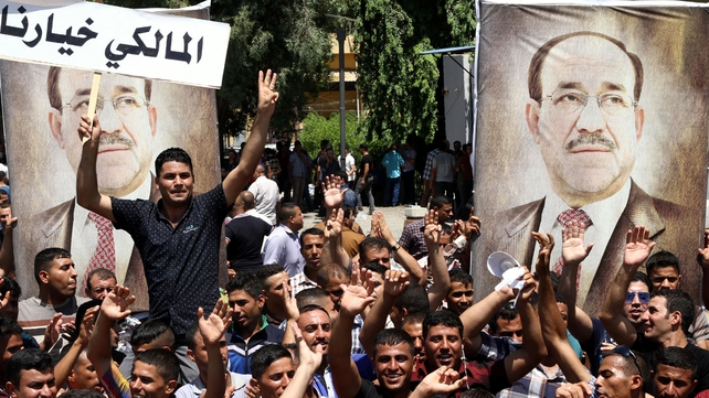 Supporters of outgoing Iraqi Prime Minister Nuri al-Maliki protest in central Baghdad