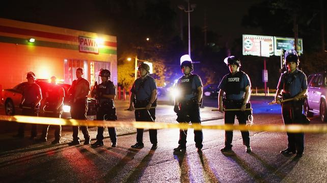 Police lock down a neighbourhood in Ferguson, Missouri