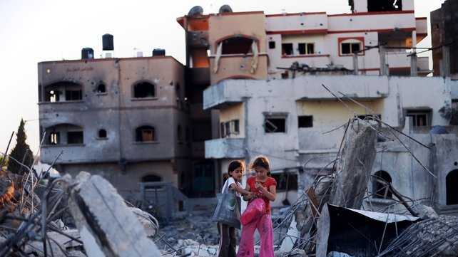 Children look at some of the belonging they salvaged from their destroyed homes in Jabalia, northern Gaza