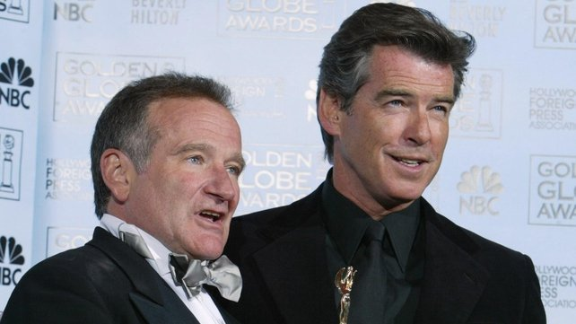 Mrs Doubtfire co-star Pierce Brosnan pictured with Williams at the Golden Globes in 2005 where Williams received the Cecil B deMille Award