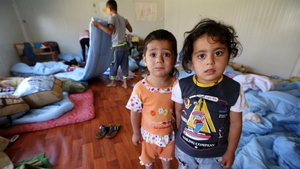 Iraqi Christian children take refuge in a room of Ainkawa's St Joseph church on the outskirts of Irbil