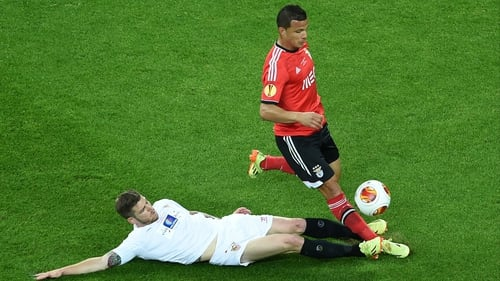 Alberto Moreno is at full stretch to tackle Benfica's Rodrigo Lima during the Europa League final