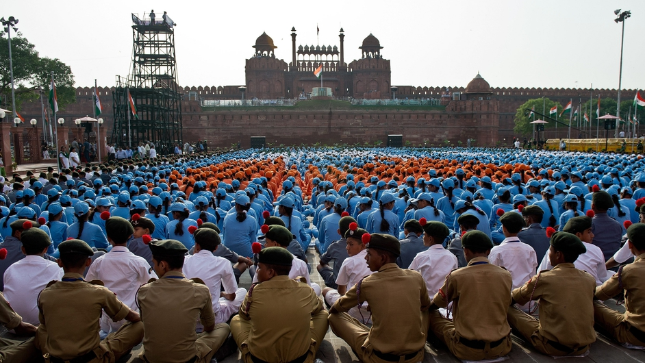 Indian schoolchildren take part in the full dress rehearsal for the 68th Independence Day celebrations at the Red Fort in New Delhi