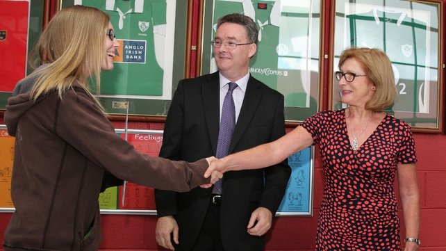 Jan O'Sullivan and St Nessan's Principal Eugene O'Brien congratulate Megan Ryan on her results