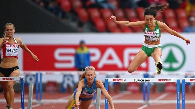 Ireland's Christine McMahon (R) avoids the falling Hanna Ryzhkova of Ukraine