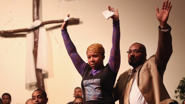 Lesley McSpadden (L), the mother of  Michael Brown joined a capacity crowd of guests at Greater St Mark's Family Church