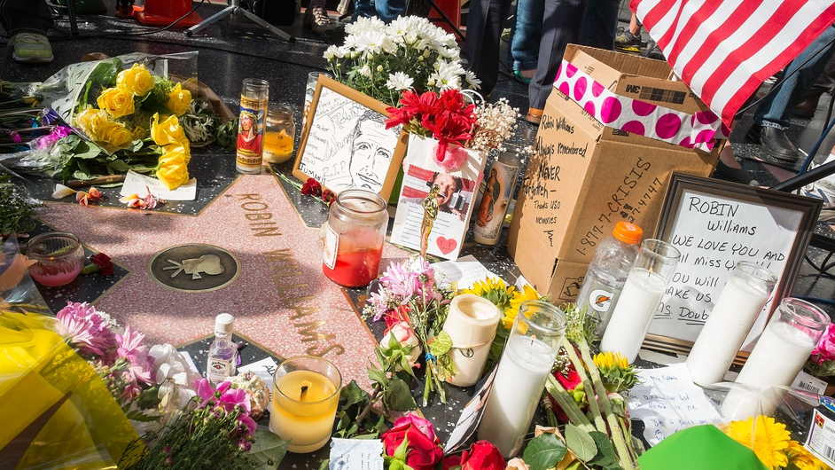 Tributes to the late Robin Williams are left at his star on Hollywood's Walk of Fame