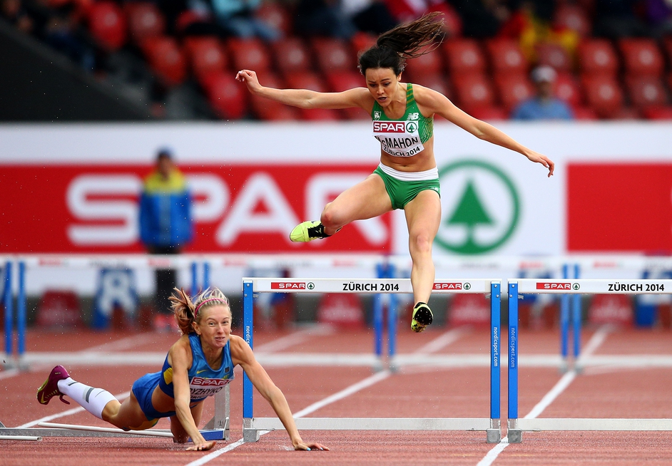 Ireland's Christine McMahon avoids Hanna Ryzhkova of Ukraine during the heats of the 400m hurdles at the European Championships in Zurich