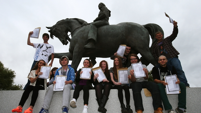 Leaving certificate students from Trinity Comprehensive in Ballymun celebrate with their results