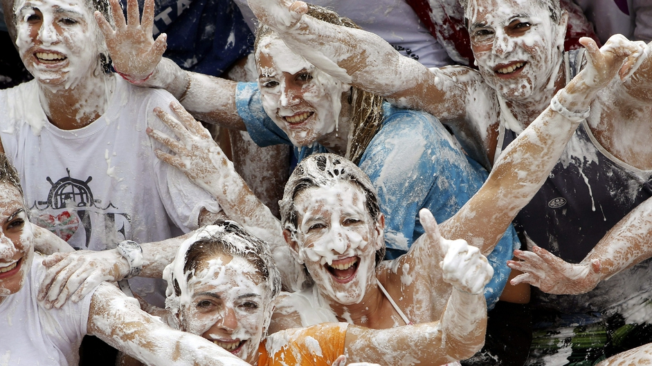 People enjoy a meringue fight on the occasion of San Sebastian's Semana Grande regional festivities in Spain