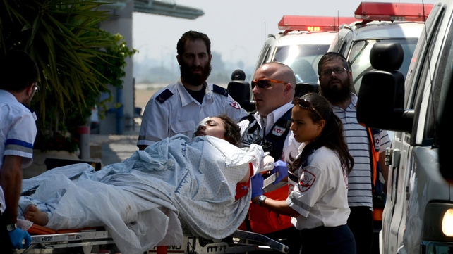 Israeli Red Cross workers wheel a wounded Palestinian girl into a terminal at Ben Gurion Airport as a group of Palestinian wounded are brought to Turkey for treatment