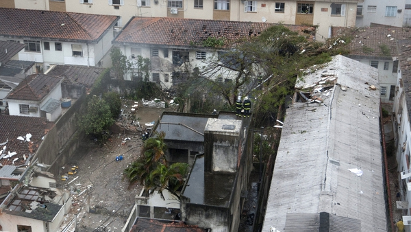 Damaged buildings where the aircraft crashed in the residential area Na Rua Vahia de Abreu in Santos