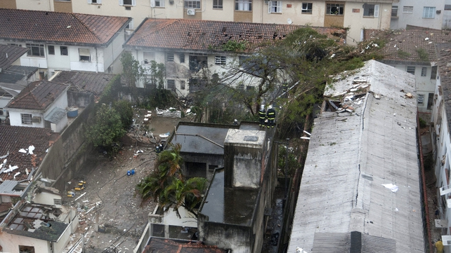 The plane crashed into houses in Santos city in bad weather