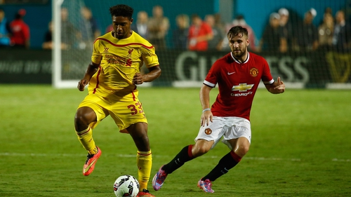Jordon Ibe of Liverpool under pressure from Man United's Luke Shaw