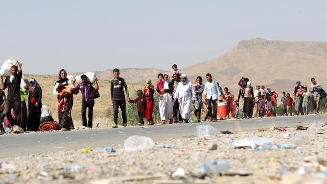 Displaced Yazidis cross the Iraqi-Syrian border at the Fishkhabur crossing