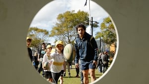 Matt Toomua watches students from a local school pass a rugby ball during the Bledisloe Cup Fan Day in Sydney