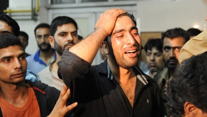 The brother of a dead policeman reacts at a hospital in Srinagar after rebels shot dead two policemen and a civilian in Indian Kashmir