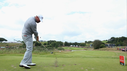 Thomas Bjorn of Denmark hits his tee-shot on the second hole