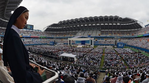 Thousands attend a mass conducted by Pope Francis at Daejeon World Cup Stadium