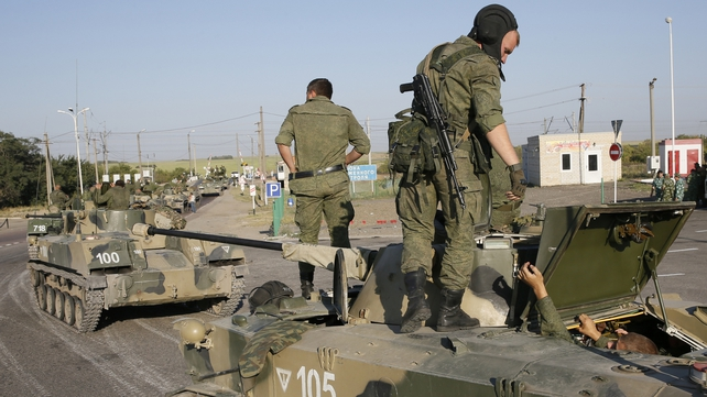 Russian armoured vehicles have stopped on a road outside the town of Kamensk-Shakhtinsky