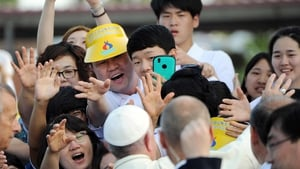 People cheer Pope Francis during his visit to the shrine of Solmoe