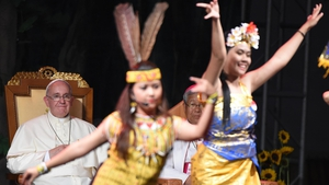 The pontiff watches as dancers perform on stage at the Asia Youth Day event in Solmoe