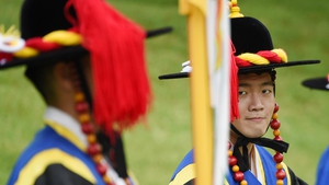 A south Korean soldier in a traditional warrior outfit reacts as he waits for Pope Francis