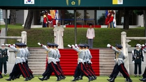 Pope Francis and South Korean President Park Geun-Hye inspect South Korean honour guards during a ceremony at the presidential Blue House in Seoul