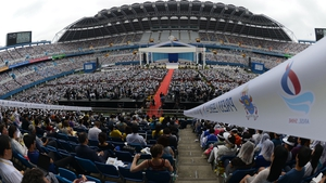 Thousands of followers attend a mass con-celebrated by Pope Francis at Daejeon World Cup Stadium