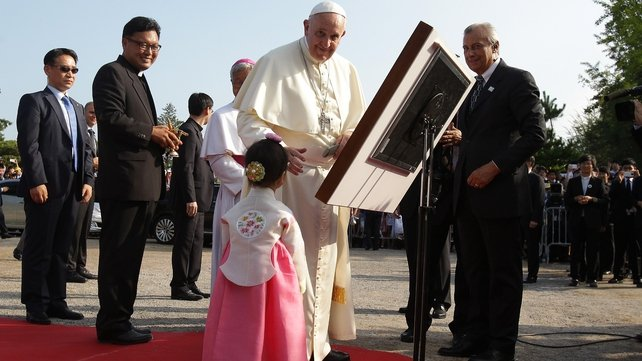 The pontiff signs the guest book at the shrine of Solmoe, house of St Andrew Kim Taegon