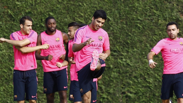 Luis Suarez trains with his Barca team-mates today