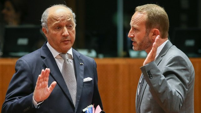 French foreign minister Laurent Fabius (L) chats with his Danish counterpart Martin Lidegaard at the EU meeting