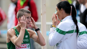 Rob Heffernan with his coach and wife Marian Heffernan after withdrawing from the 50km walk