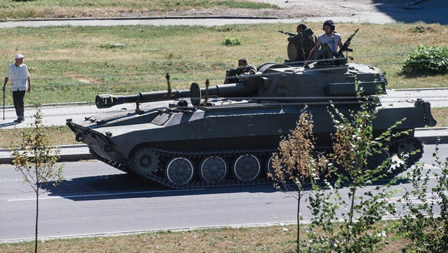 A pro-Russian tank moving along a street in Donetsk