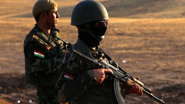 Iraqi Kurdish Peshmerga fighters take position on the front line in Khazer, near the Kurdish checkpoint of Aski kalak, 40km west of Irbil
